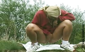Blonde college girl shitting outdoor