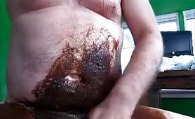 Chubby guy smearing saved brown poop on his belly and cock