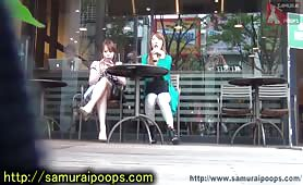 Two sexy Asian girls using a public bathroom