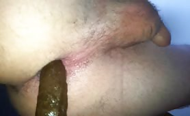 Young boy pooping a green turd in close up
