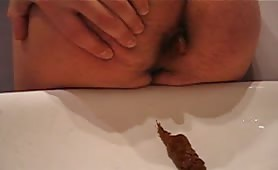 Shitting in the sink while stroking his cock