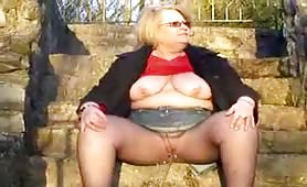Blonde granny peeing in public