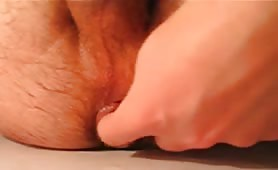 Fingering his purple asshole