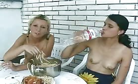 Lesbian girls peeing while eating