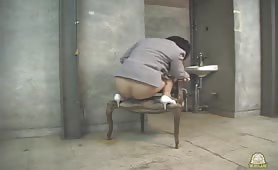 Mature woman shitting on a chair