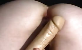 Blonde lady shitting on her dildo