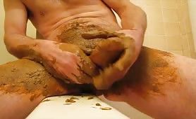 Masturbating hard with poop on his long cock