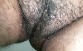 Hairy babe pooping in close up