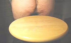 Fat turd on a wooden plate