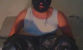 Masked man eating shit