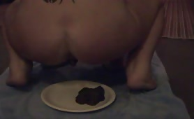 Sexy girl pooping on a plate