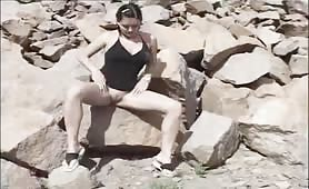Wild girl peeing on rocks
