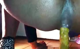 Ebony slut Caroline taking piss and poo on floor