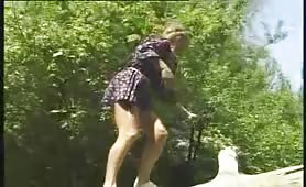 Woman pissing in the garden