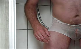 Man pooping and pissing on his underwear