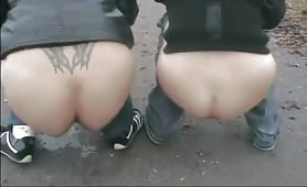 Two Girls Pooping on the road