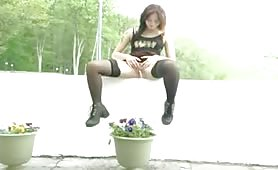 Tattooed Girl pissing in the flower pot