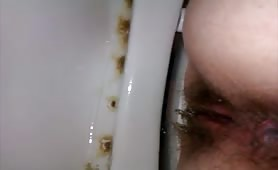 wife shitting on the toilet pooping close up