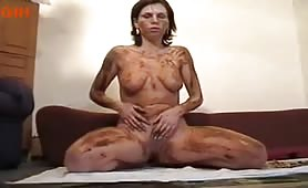 Masturbating chick covering herself in scat