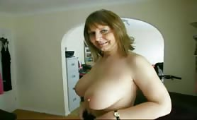 Sexy milf playing with her tits and pissing
