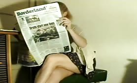Amateur chick farting and reading a news paper