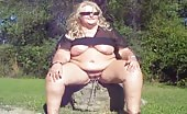 Fat blonde woman peeing outdoor